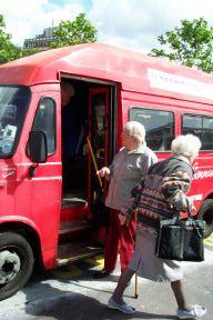 People boarding a bus