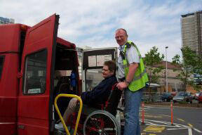 Wheelchair user being helped onto bus
